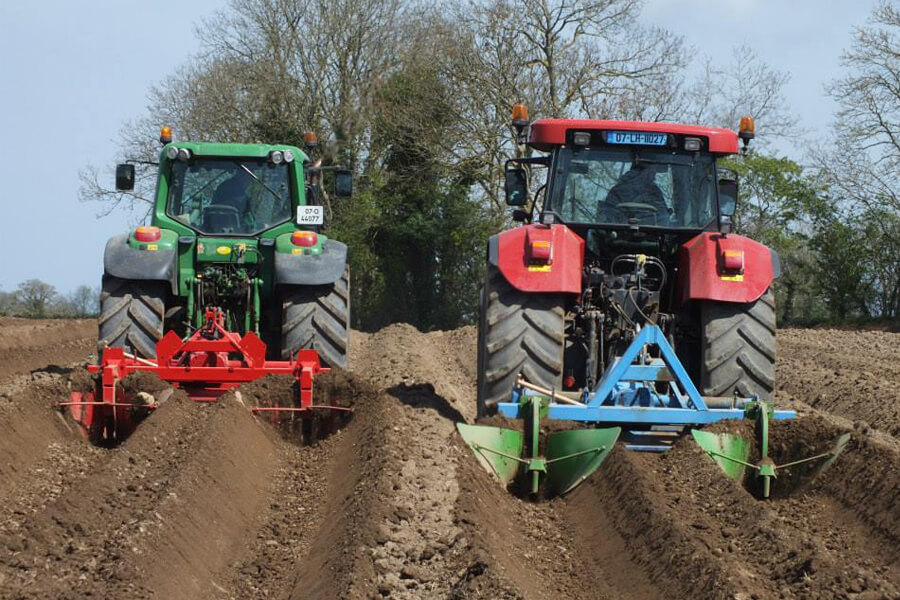 Keoghs tractors ploughing field