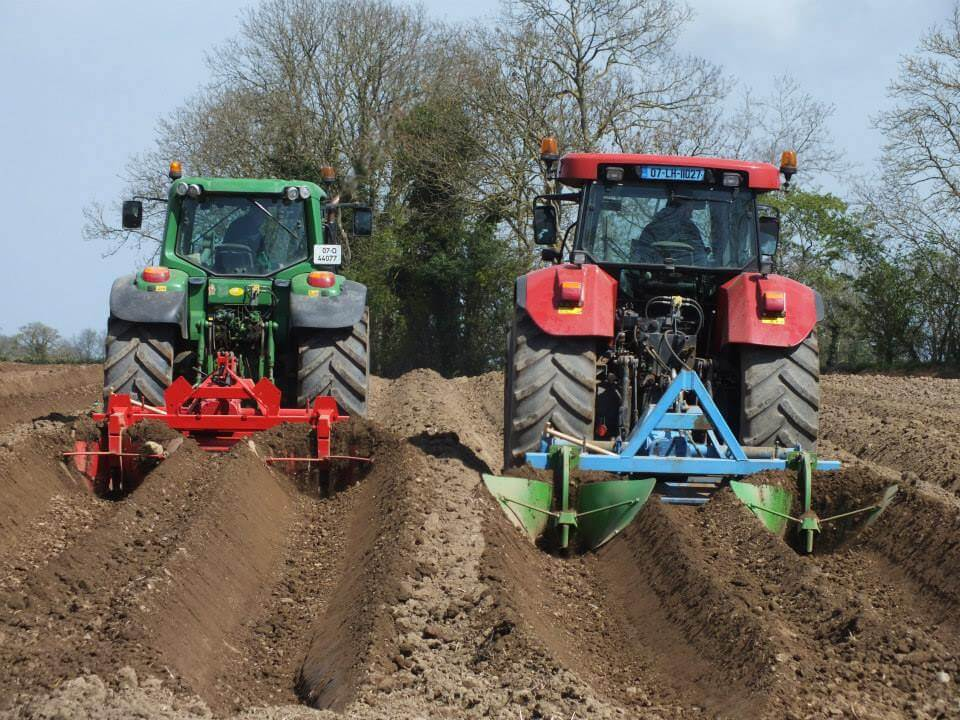 Keoghs crisps tractors ploughing field